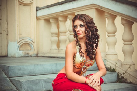 red pants: girl sitting on the stairs of the Palace in red pants