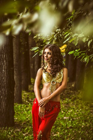the girl in the woods in costume for dancing