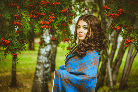 red berries: girl standing in the blanket under the red berries