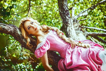 rapunzel: Beautiful young woman with long hair braided in a braid, is a tree.