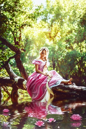 rapunzel: Beautiful young woman with long hair, twisted into a braid, sitting by the lake with water lilies.