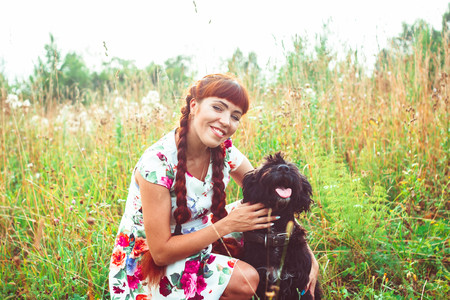 trusting: Beautiful woman playing with her dog. Outdoor portrait. series