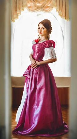beautiful woman in vintage dress in an old apartment