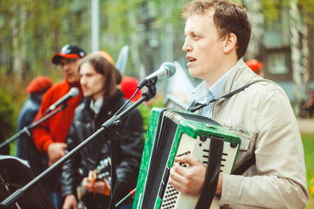 soloist: musicians sing songs on the street in Russia