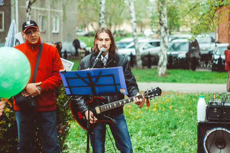 soloist: Russia, Siberia, Novokuznetsk - may 9, 2017: musicians sing songs on the street on victory day Editorial