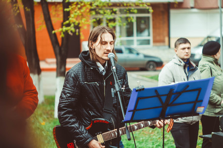 instrumentalist: Russia, Siberia, Novokuznetsk - may 9, 2017: musicians sing songs on the street on victory day Editorial