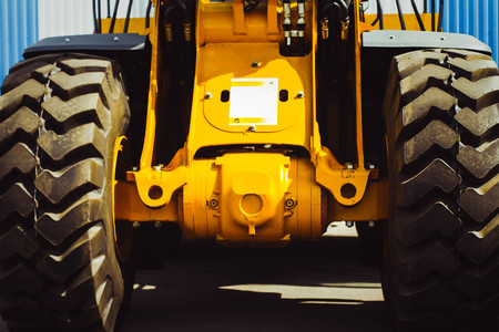 The hydraulic tractor is yellow. Crawler bulldozer at the exhibition Stock Photo