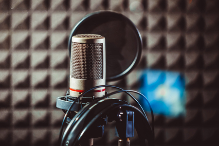 absorption: The microphone in the recording studio stands on the counter Stock Photo