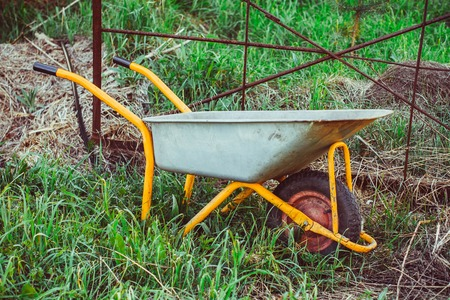 A trolley for building in the garden stands on the grass Stock Photo