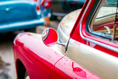 The red door of an old Soviet car