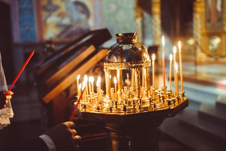 ambiance of church, candles and bokeh yellow lights