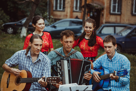 Russia, Novokuzneck - 7.04.2013: musicians sing in the courtyard in Russia