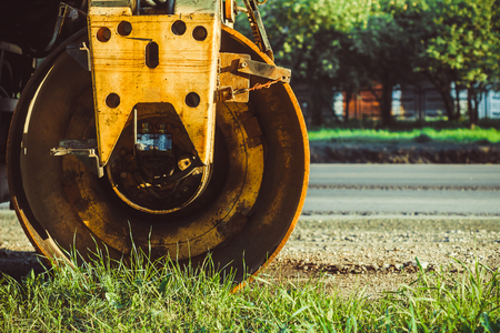 roller compactor: Laying asphalt into the city with a roller