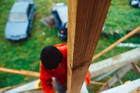Roofer builder worker installing roof insulation material Stock Photo