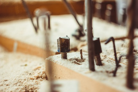 hole: the drill is in the sawdust, among other tools Stock Photo