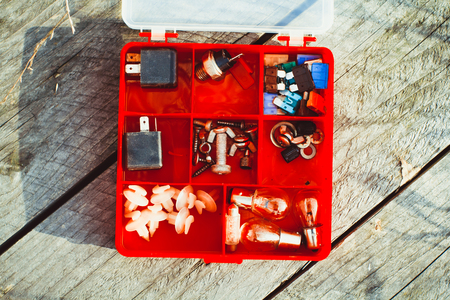 Accessories for needlework in a box with cells. Stuff. Small depth of sharpness. Horizontal format. Indoors. Without people. Color. Photo. Stock Photo