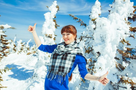 a woman in winter in the mountains showing hand class