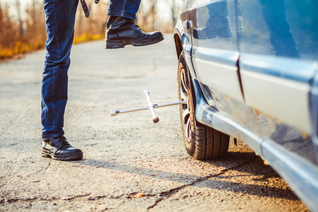 Change a flat car tire on road with Tire maintenance, damaged car tyre Stock Photo