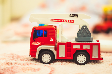 toy truck for baby cot in the room