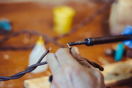 melting solder wire on soldering iron tip Stock Photo