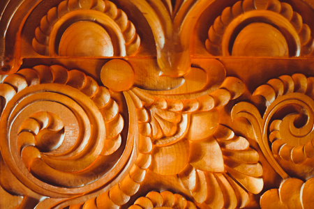 background: woodcarving fragment of a wooden homemade casket closeup