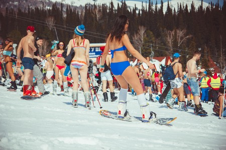 Sheregesh, Kemerovo region, Russia - April 16, 2016: Grelka Fest is a sports and entertainment activity for ski and snowboard riders in bikini.girl bikini swimsuit on a snowboard