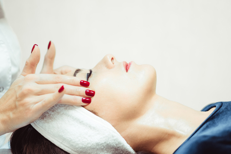 Young, beautiful and healthy woman in spa salon. Traditional oriental massage therapy and beauty treatments. Stock Photo