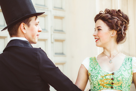 couple in ballroom attire dancing at the Palace