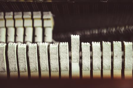 Vintage piano hammer mechanism. Prepare to repair.