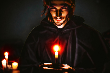 Warlock with a candle in the dark scary look Banque d'images