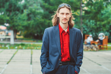 a men with long hair in buisness Stock Photo