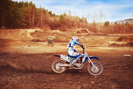 Novokuzneck, Russia - 21.04.2018: the competition in motocross on a muddy track