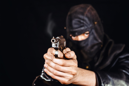 terrorist in a leather mask holding a knife