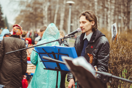 Russia, Siberia, Novokuznetsk - may 9, 2017: musicians sing songs on the street on victory day Editorial