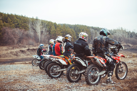 Novokuzneck, Russia - 21.04.2018: Close-up of biker sitting on motorcycle in starting point before the start of the race Redakční