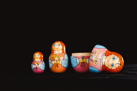 Russian nesting doll stands on a black background