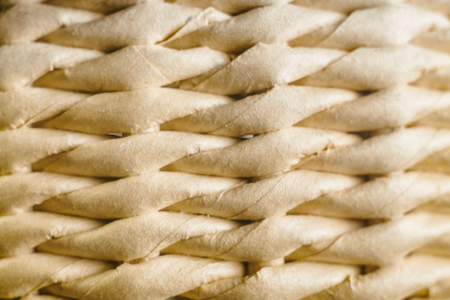 Braided paper background, close-up, macro texture photo