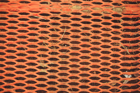 texture of old rusty metal lattice orange color