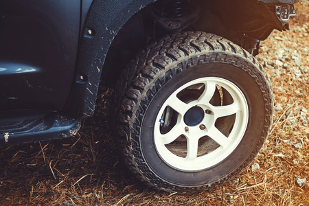 off-road wheel in the mud standing on the grass before the start