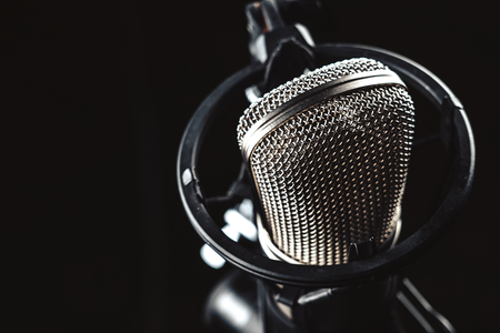 professional Studio condenser microphone on black background