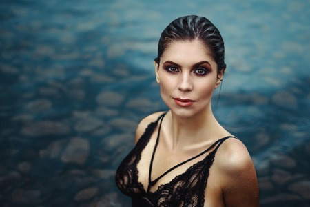 Sexy brunette, sensual attractive woman with beautiful Breasts in the water Standard-Bild
