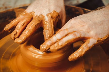 Potter at work. makes a jug out of clay Stock Photo