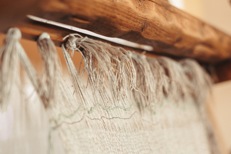 Close - up of threads in old loom, used for weaving rug