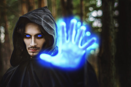 the black monk pointing his finger in the woods Banco de Imagens