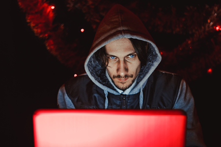 the hacker behind the computer before the new year Stock Photo