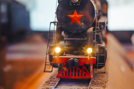 Black model Locomotive on track layout with headlamp