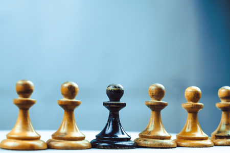 Black pawn is one of the white chess pieces Stock Photo