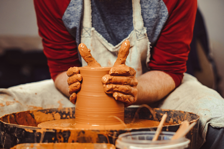 Potter at work. makes a jug out of clay Stock fotó