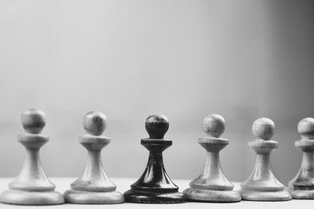 Black pawn is one of the white chess pieces Standard-Bild