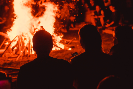 Two friends are sitting around a campfire and just relaxing Stock fotó